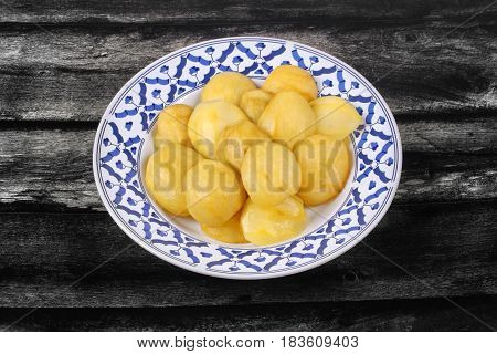 Mini Green Mango Compote Served In Thai Pattern Plate.