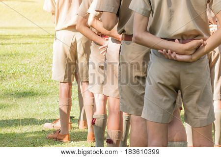 blurred of asian thai boy scout standing in line for activity camp