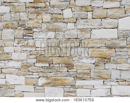 Stone wall texture. Rock wall background. Abstract texture and background for designers. Close up view of rock bricks.; Solid stone wall.