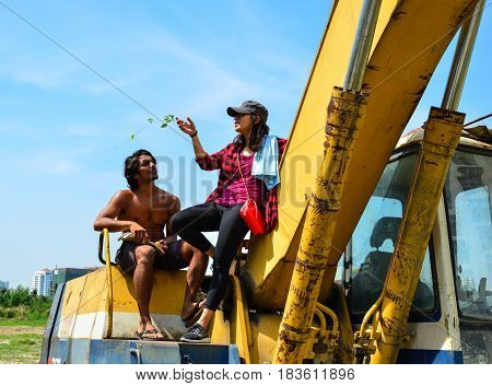 Young Couple Playing On Construction Machine