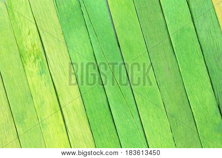 This is a photograph of Green colored popsicle sticks background
