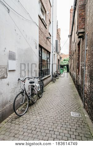Bruges Belgium - July 29 2016: Empty street in the city of Bruges. The historic city centre is a World Heritage Site of UNESCO. It is known for his picturesque cobbled lanes and dreamy canals