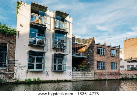 Mechelen Belgium - July 29 2016: Cityscape of Mechelen with old rehabilitated buildings on the canal. Extension of an old building with modern architecture elements.