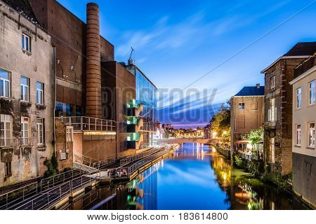 Mechelen Belgium - July 29 2016: Cityscape of Mechelen from the canal at sunset. Mechelen is one of most prominent cities of historical art in Flanders