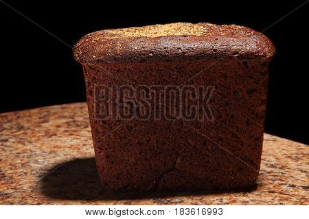 Black bread on the table. close-up