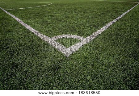 Football field Point corner kick. Green synthetic grass. Closeup