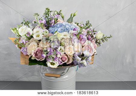 Still life with a bouquet of flowers. the florist put together a beautiful bunch of flowers. Man manual work used different types of flowers and colors.