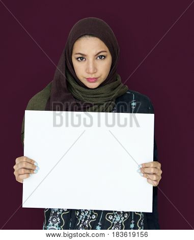 Woman standing and holding Banner