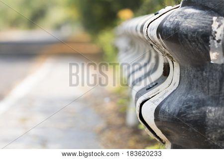 background textured iron bar beside way safe accident