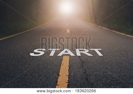 Conceptual image with word start on asphalt road   / Start Your Life