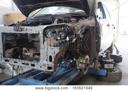 Stupinio, Russia - April, 18, 2017: Car on a stocks in a car body shop in Stupino, Russia