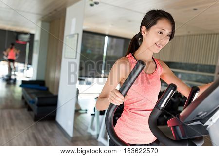 Sport Woman practice on Elliptical machine