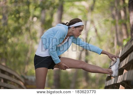 Hispanic woman stretching