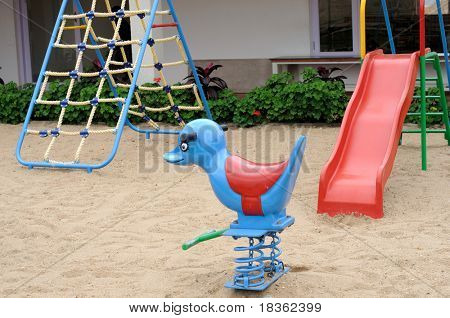 Children play area on a bright summer day poster