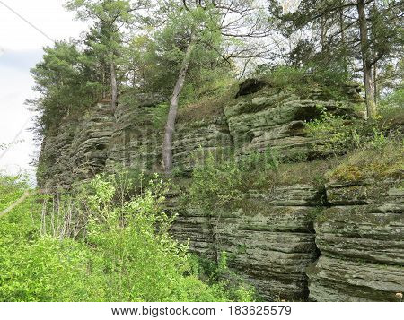 Limestone and Sandstone cliff along Illinois Route 176 leading to Starve Rock State Park in Spring