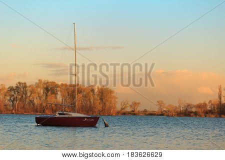 Yacht To The Lake In The Drift In The Rays Of The Sunset