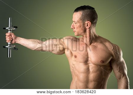 man with powerful biceps using dumbbell isolated