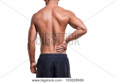 Man with pain in shoulder against white