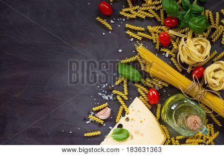 Ingredients For Cooking Italian Pasta - Spaghetti, Fusilli, Fettuccine, Basil, Cherry Tomato, Garlic