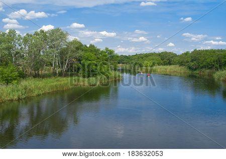 Landscape with small Ukrainian river Samara at summer season.