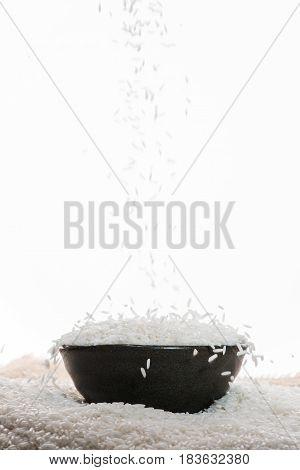 White Rice Falling Down. Jasmine Rice, Thai Rice, Raw Rice.