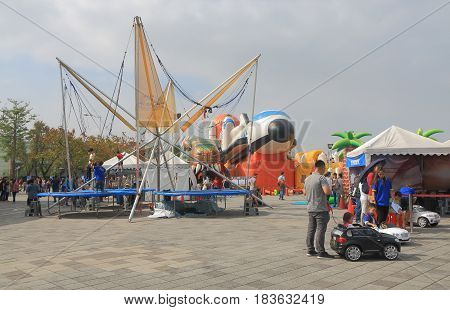 TAIPEI TAIWAN - DECEMBER 4, 2016: Unidentified people visit Taipei Expo Park amusement park.
