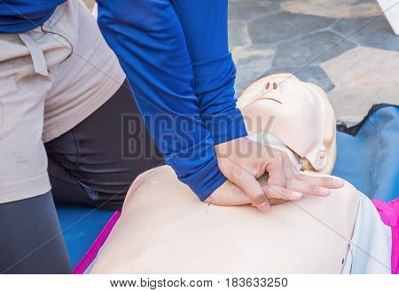 cpr training chest compression dummy basic life support selective focus of hand
