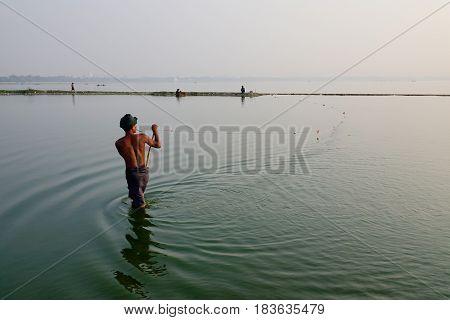 People Catching Fish On Lake In Mandalay, Myanmar