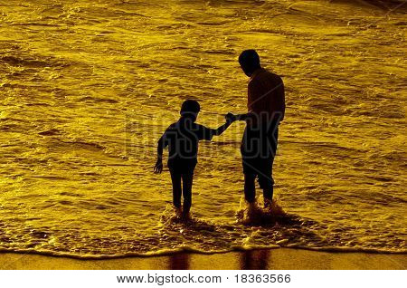 Father and son having intimacy at a local beach