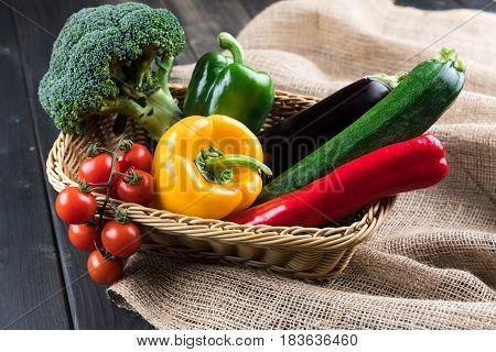 Close-up View Of Fresh Seasonal Vegetables In Basket On Sackcloth