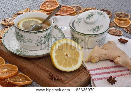 Breakfast tea with ginger and lemon. Healthy. Teabag, citrus. Closeup