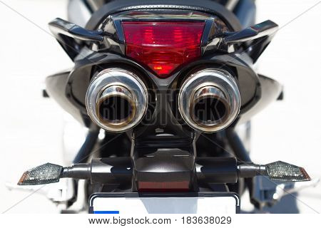 rear view of sport motorcycle pair of exhaust pipes