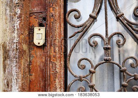 Old Door Bell On The Vintage Dirty Door