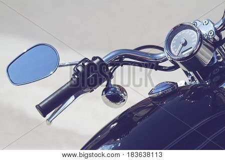 custom black classic motorcycle handlebar and chrome mirror isolated in white background