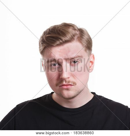 Disappointed. Negative emotion. Man with sad face, grimacing on white studio background, cutout