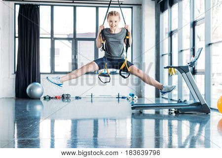 Preteen Girl Training With Resistance Bands In Fitness Class. Gym Class Kids Concept