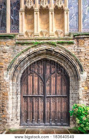 Old door with brick wall at England, UK.