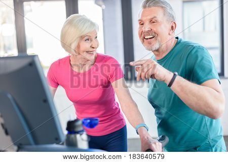 Old Sport Couple Training On Treadmill In Fitness Class For Senior People
