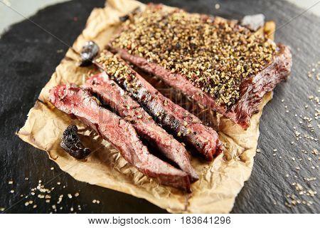 Restaurant Grilled Food - Delicious Grilled Pepper Steak. Gourmet Restaurant Steak Menu. Pepper Steak Served on Parchment