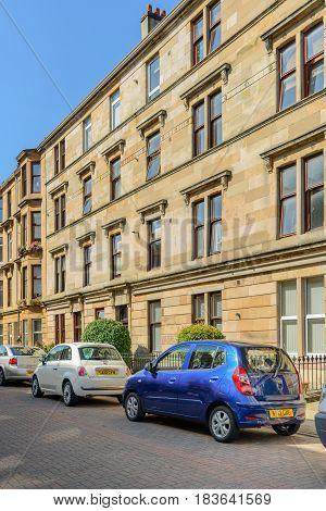 GLASGOW SCOTLAND - AUGUST 16 2016: A sandstone residential building in White Street off Byers Road in the West End of Glasgow.