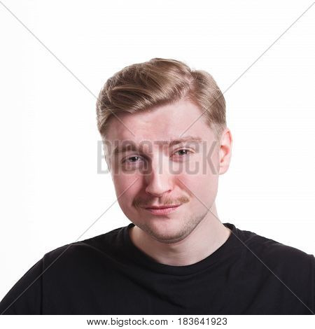 Mistrustful man with sly smile, makes fun of something. Facial expressions, portrait isolated on white