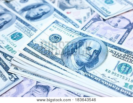 Blue one hundred dollar bills background textured