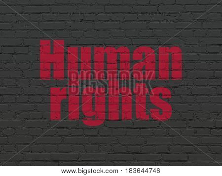 Political concept: Painted red text Human Rights on Black Brick wall background