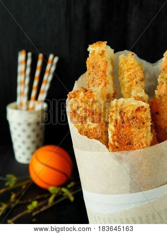 Crispy snacks in a paper bag for basketball watching
