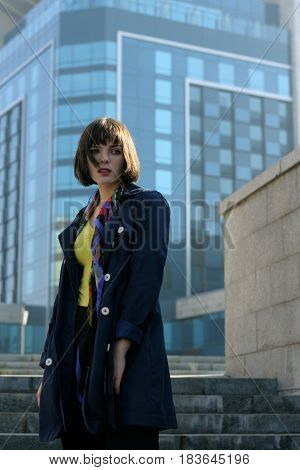 Business Woman In Formal Clothes Against The Urban Background