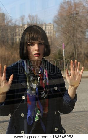 Woman Leaned Her Hands On The Window Glass