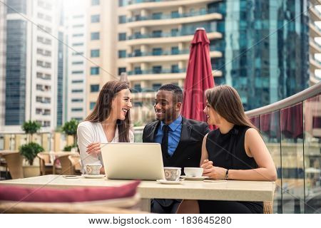 Portrait of three businesspeople having a pleasant meeting outdoors.