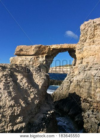Azure window natural hole of rocky cliff and blue Mediterranean sea in summertime. Famous travel destination of Malta on Gozo island