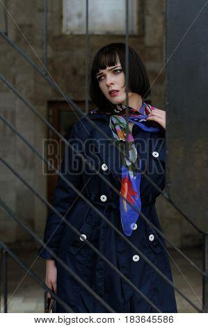 Portrait Of A Stylish Girl Near A Metal Railing