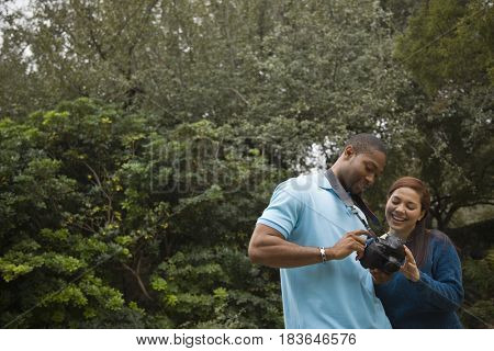 Couple looking at pictures on digital camera